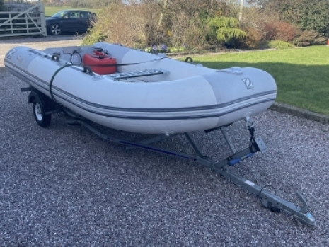 preowned infltable boat package with Zodiac cadet rib and mercury engine and trailer, all in very good condition throughout and all one careful owner from new. cadet boats are ideal for lakes, canals, ruivers and all inshore waters. the mercury engine is a prize example of a good outboard engine. this inflatable boat package is sold complete on brokerage fur awell kow customer zodiac boat, mercury engine and complete road trailer all raefy to go out on the water zodiac cadet boat is complete and mecury